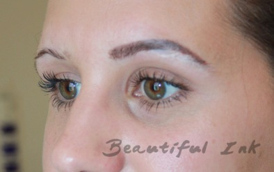During Eyebrow Design - White covers hairs to be plucked
