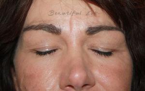 Eyebrow shape and tattoo