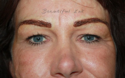 Eyebrow shape and tattoo